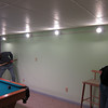 Dad shoots pool on the table he built, in the pool room he built, while I wait my turn.