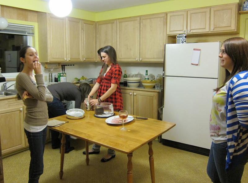 Ellie, Lisa, Katelyn and Lindsey clean up the dinner.