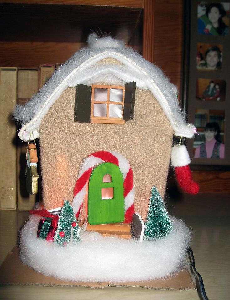 Dec 23.  The girls set up Gmom's little gingerbread house.