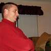"Mark listening to Lucas read a Texas ""Night Before Christmas."""