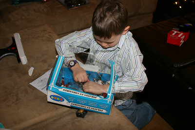 new watch from Nana - gotta get these pirate guys from Aunt Catherine out of this box!