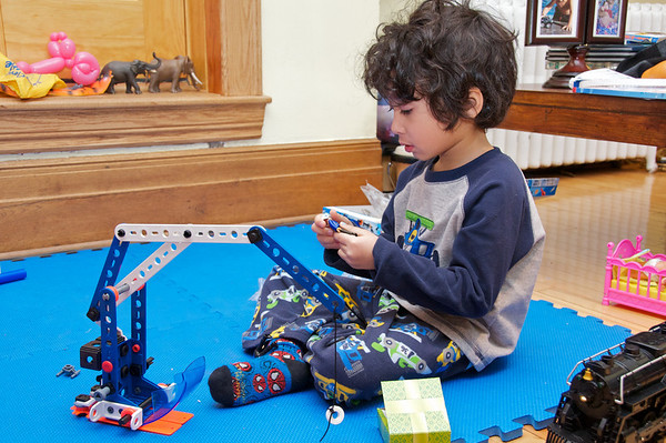 Jaden playing with his mechano set - its a crane, its a plane, its a helecopter.