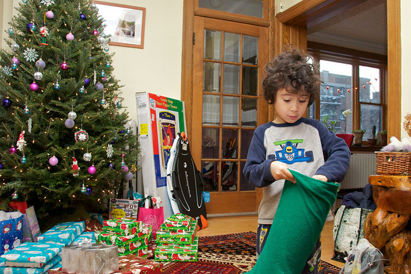 Christmas morning Jaden discovers his stocking stuffed and more presents stacked under the tree!  I'm a bit ambivalent about Santa Claus getting all the credit for this, but I'll suck it up for a few more years.