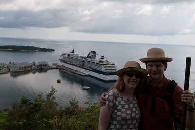 "About half way up the tallest ""mountain"" on the island, looking over the harbor with our ship. Again, remember how big this ship looks."