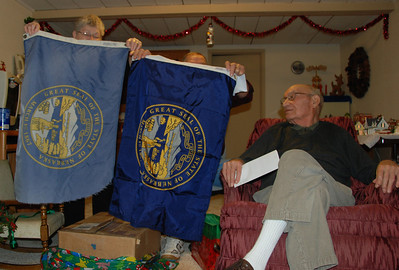 We also bought Dad a new Nebraska flag. The old one is on the left. He was trying to talk Mom into fixing it.