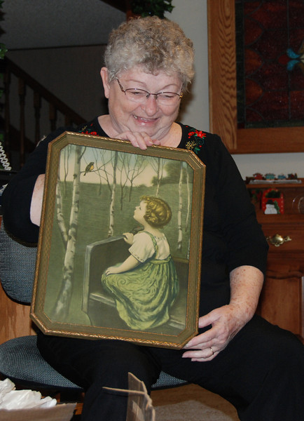 When Mom, Dad and Melinda went to see Kelly's new baby in Chicago, they stopped in the Amana Colonies on the way back. Mom saw this in an antique store and said her mother had one at her house. So sneaky Melinda called and ordered it for Mom so we could give it to her for Christmas.