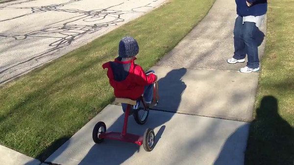 Joel rides a tricycle