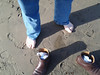 Bill taking shoes off on beach!