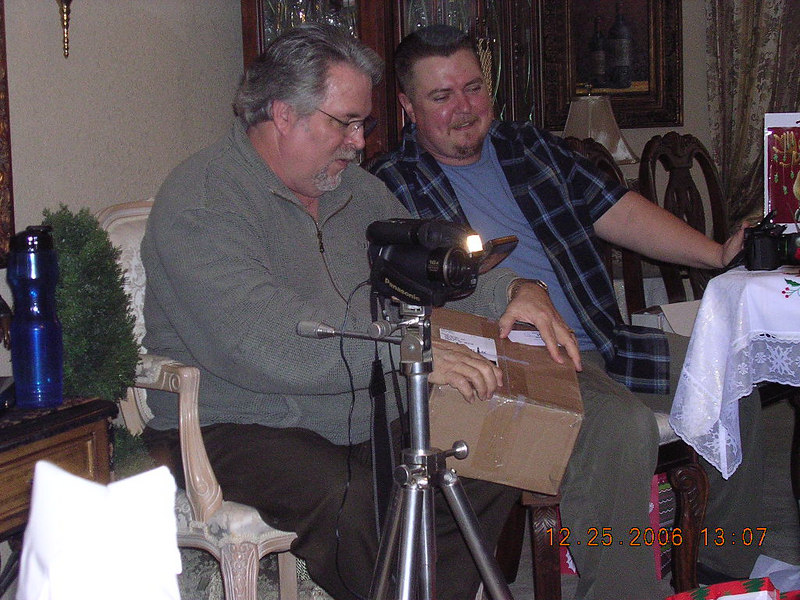 Jeff opening one of his gifts. He is the movie maker of the group.