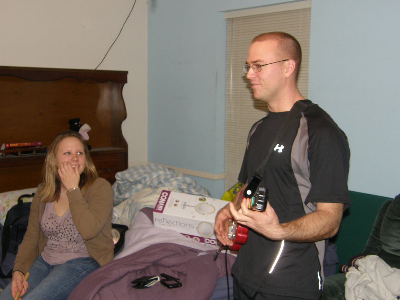 Katie and Luke discuss the finer points of Guitar Hero.