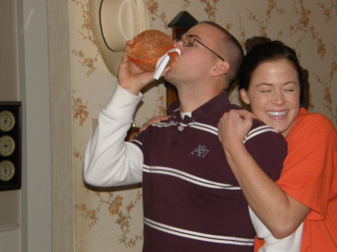 Luke drinking coconut milk and Sarah hugging her bubba.