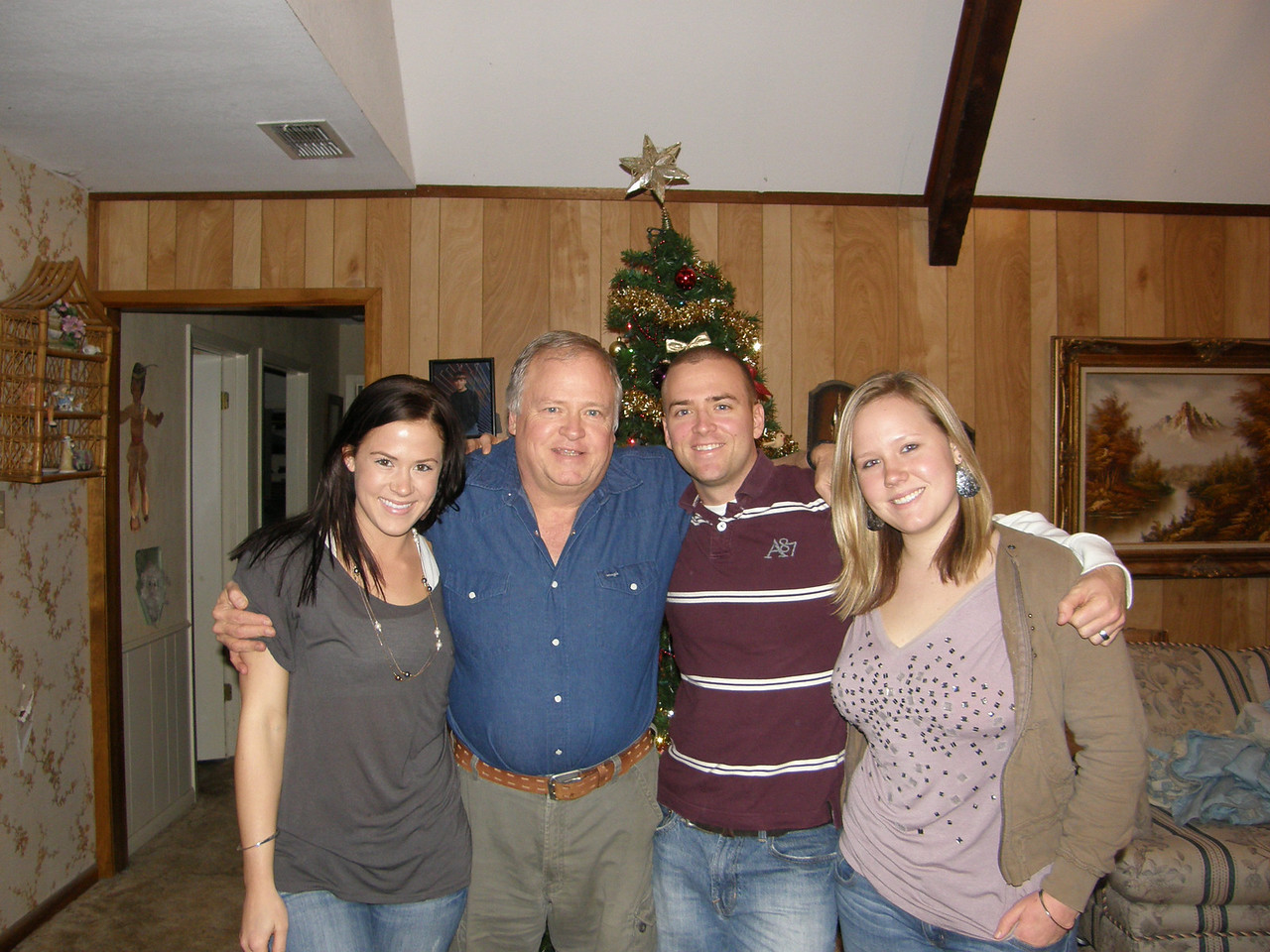 Sarah, Daddy, Luke, and Katie chllin in front of the Christmas tree!