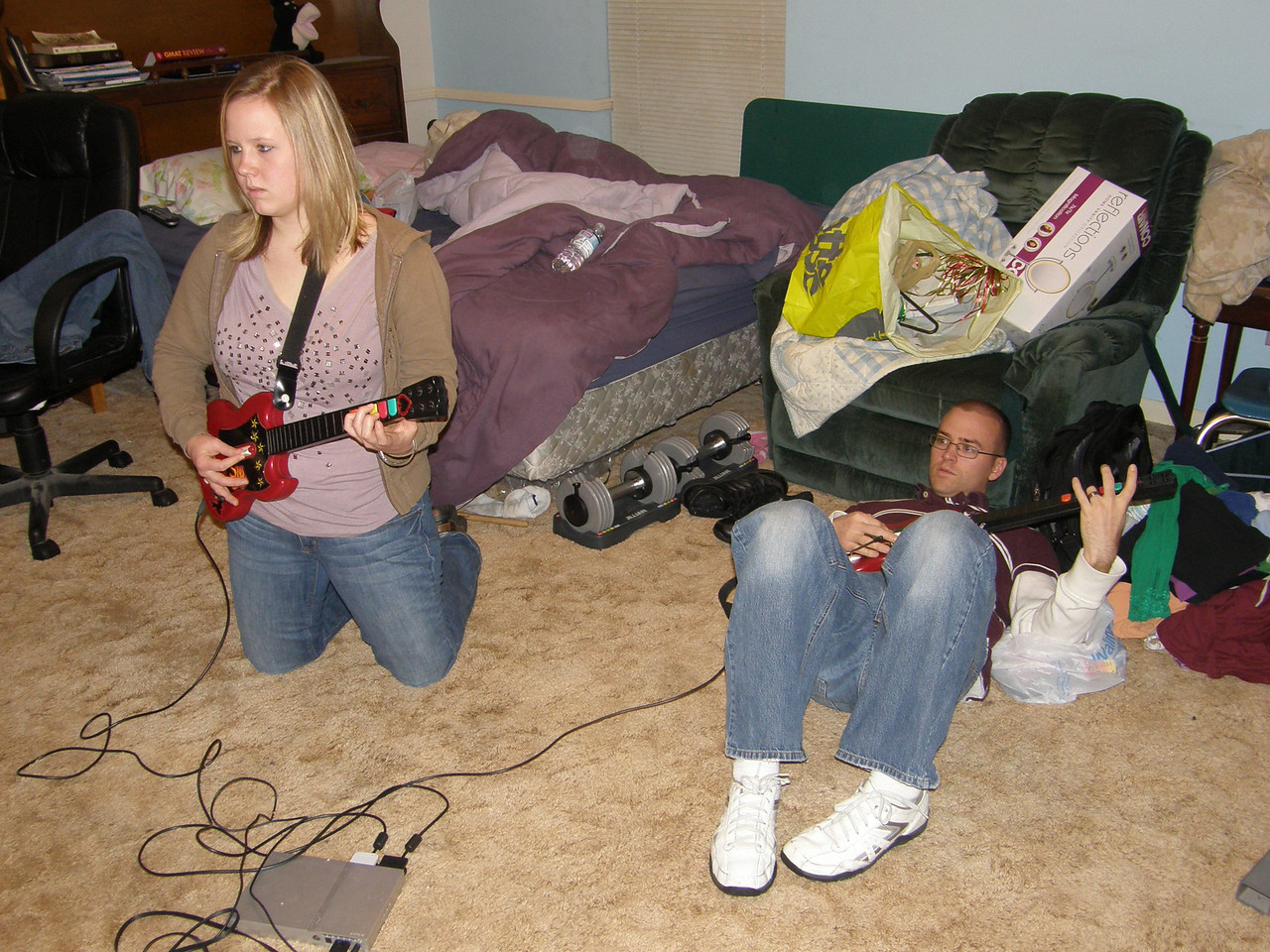 Although they look sad, they are really just intense.  They play Guitar Hero on some of the hardest settings!  Awesome.