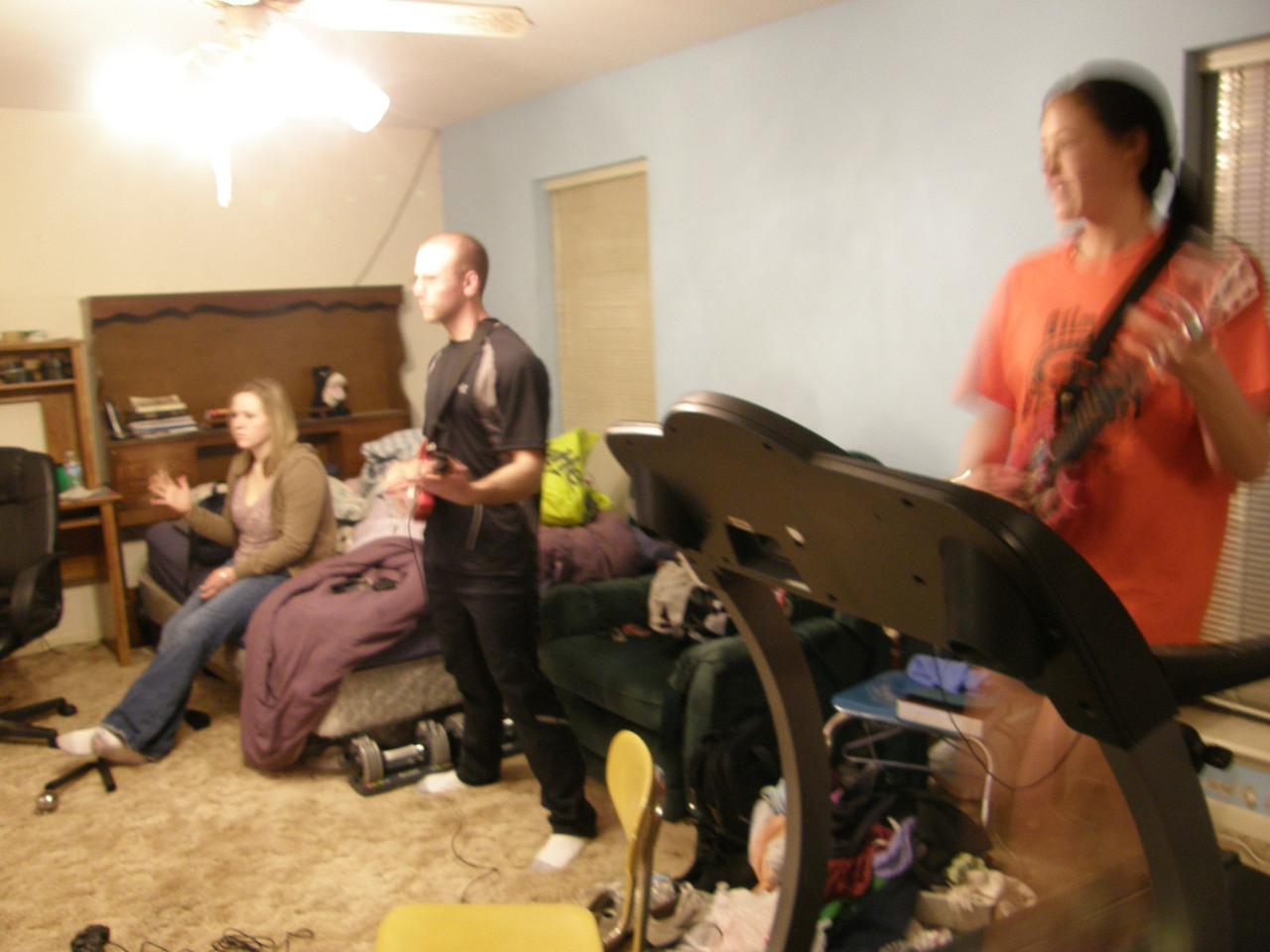 I'm a Guitar hero yea yea yea.  Katie, Luke, and Sarah.
