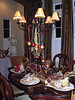 Table #3 in the dinning room with the beauriful chandelier all decorated.<br /> <br /> Now I have to say, when we all opened our gifts at the place settings...each one was an exquisite orniment...they were breath takingly beautiful. Every one was different. All hand crafted. Thank you so much Ron and Lori.