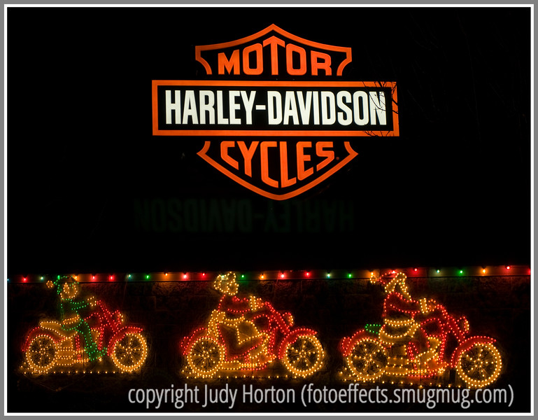 These Decorations Outside A Harley Davidson Store Have Been Combined With The Neon Sign