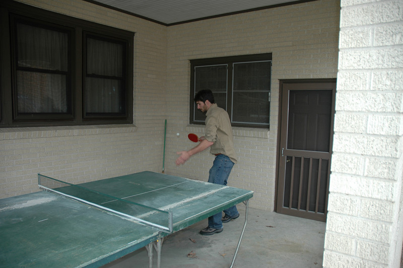 Aaron playing ping pong with Daniel