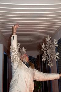 Helen hanging Snowflakes