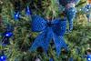 Christmas tree ornament; blue simulated pierced ribbon bow