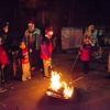 Children roast marshmallows during the Cleghorn Neighborhood Center winter lights toy drive in Fitchburg on Friday evening. SENTINEL & ENTERPRISE / Ashley Green