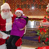 Minerva Servin, 4, meets Santa during the Cleghorn Neighborhood Center winter lights toy drive in Fitchburg on Friday evening. SENTINEL & ENTERPRISE / Ashley Green
