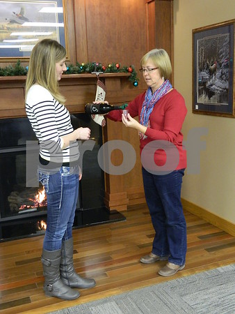 left to right: Amanda Strouse and Tammi Secor sampling some wine from the Soldier Creek Winery.