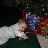 Violet playing under the Christmas tree.