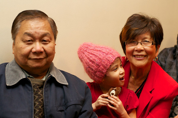 Happy grandparents with Cyane who is pleased as punch with her chocolate bear