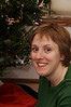 Sarah sitting by the Christmas tree