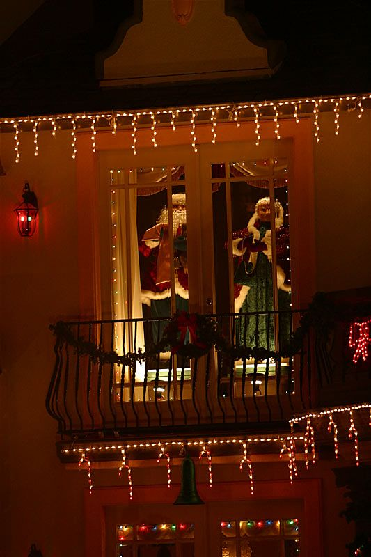 Mr. & Mrs. Claus peer out the windows.