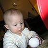 Christmas Eve, checking out the football Sherri got him