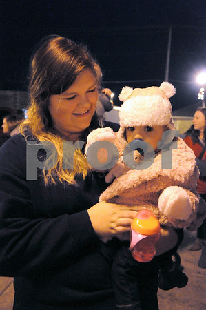 -Messenger photo by Joe Sutter<br /> <br /> Victoria Coleman brought her daughter Isabella Coleman, 1 year old, to experience Lights on Central for the first time.