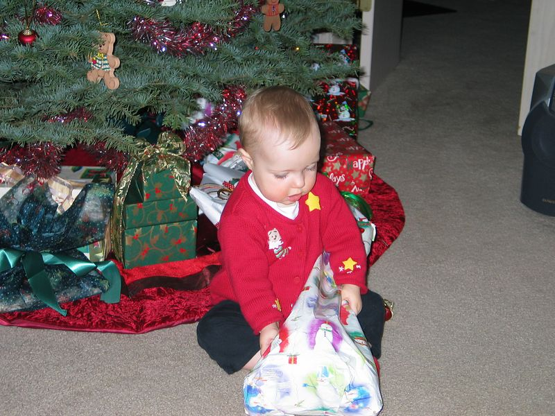 Sydney opening her gift from Aunt Carolyn.