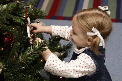 Mary trims the tree.
