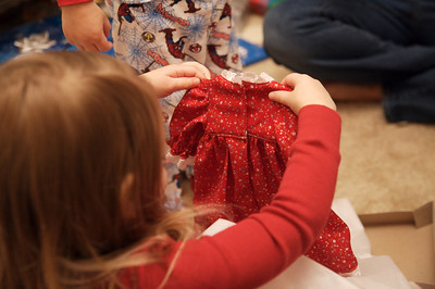Opening gifts.  A baby doll dress made by Gramma