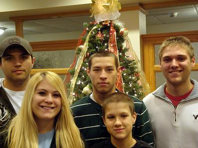 Cory, Alex, Brady, Cassie and Gavin by the Christmas tree ( 2010 )