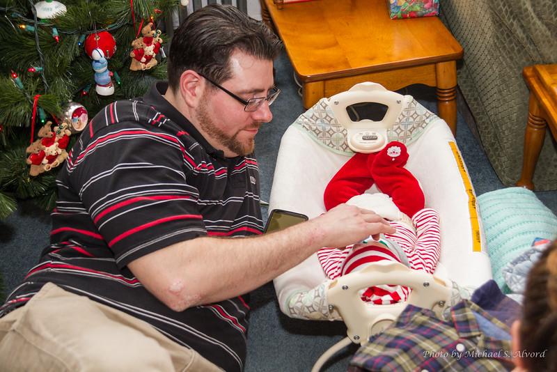 Proud papa taking care of Zachary.