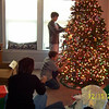Lori, Cory and Alex decorating the tree