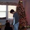Lori, Alex and Cory decorating the tree