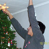 Cory putting the star on the tree