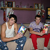 Cory and Alex opening their gifts from mom and dad.