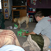 Alex and Todd helping Louie open a present on Christmas morning.