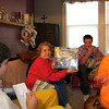 Cory, Kay, Alex and Gavin exchanging christmas presents