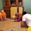 Gavin, Cassie and Cory putting together the race track