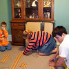 Gavin, Cassie and Cory putting together a race track