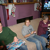 Alex and Cassie wait to open their gifts while Grandmas Kay gets a new blanket.