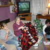 Cassie, Grandma Kay and Lori opening presents on Christmas Eve.