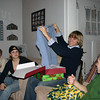 Brady holds up a new shirt to Grandma Kay, Cassie and Alex