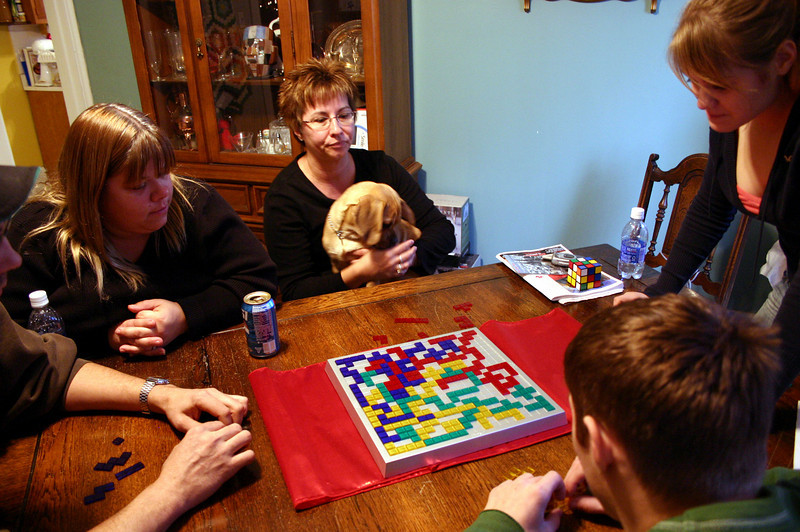 Nathan, Kim, Lori, Louie, Cassie and Alex playing a game of blokus on Christmas Eve.