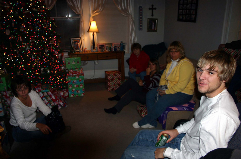 Lori, Kay, Cassie, Kim and Brady getting ready to open presents.